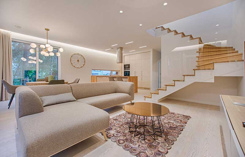 well designed living room with stairs