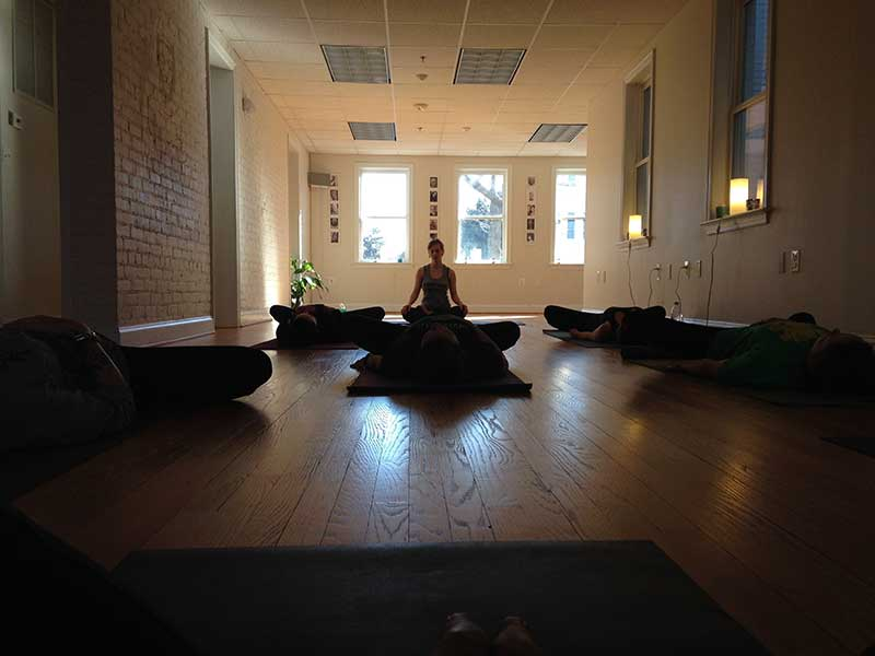 instructor with her students inside a zen meditation room