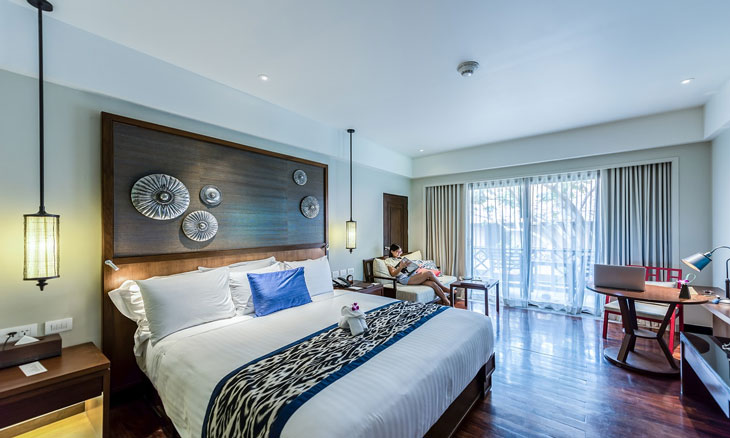 Transitional bedroom decor with window view