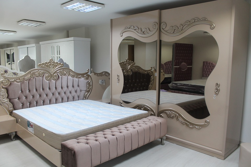 Bed besides mirror