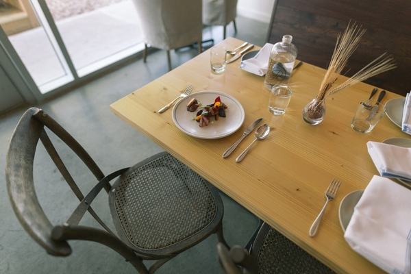 white ceramic plates, table, and chair