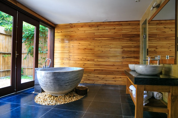 wooden wall bathroom with ceramic bathtub and lavatory