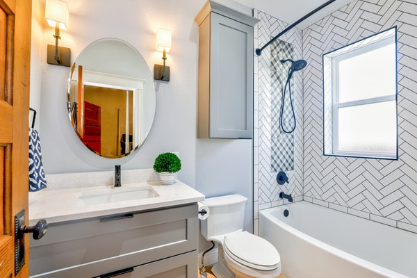 bathroom with oval mirror
